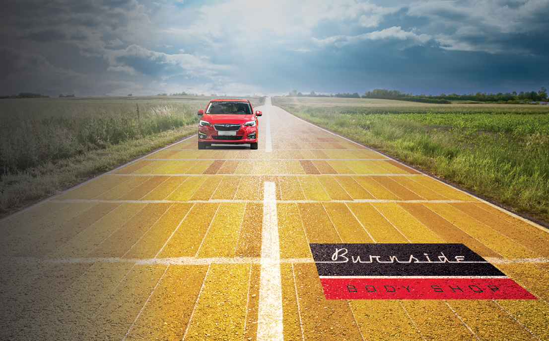 Image showing car driving down yellow brick road.