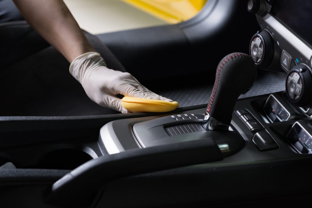 wiping car interior to disinfect it